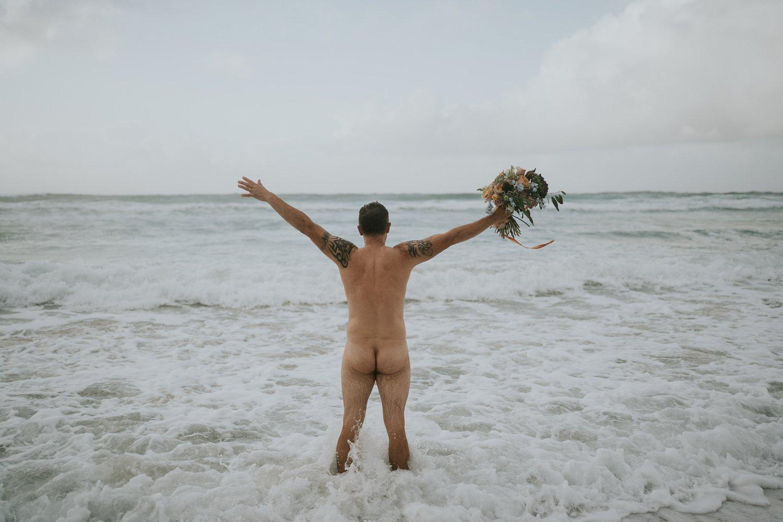 Simon goes wild - wedding groom naked with wedding flowers in the sea